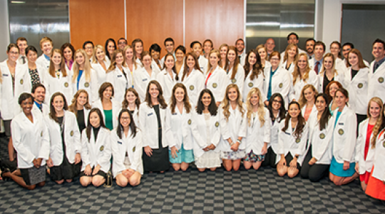 PA Students pose in white coats