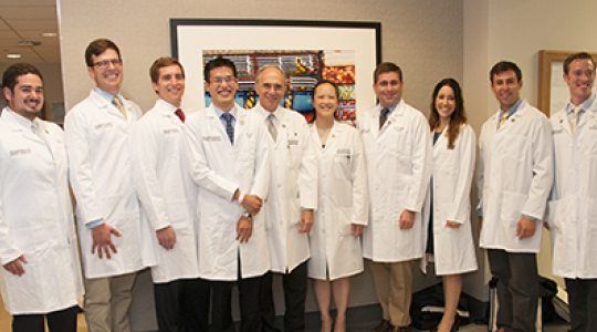 first-year residents pose with Dr. Sidawy