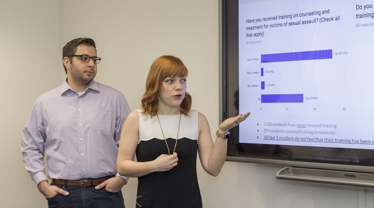 Woman points at screen during presentation