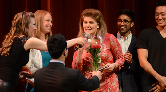 Students present Ellen Costello with flowers