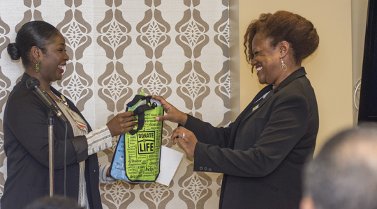 Dowan McNair-Lee, right, accepts a gift of appreciation after donating a kidney to her mother, Anola.