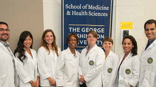 Members of th class of 2016 in white coats