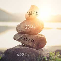 Spirit, soul, mind, and body written on rocks