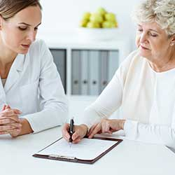 female nurse explaining results with elderly patient
