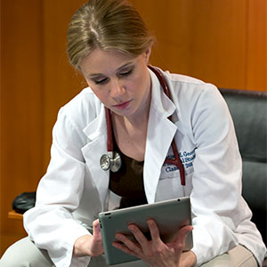medical student studying material on her tablet