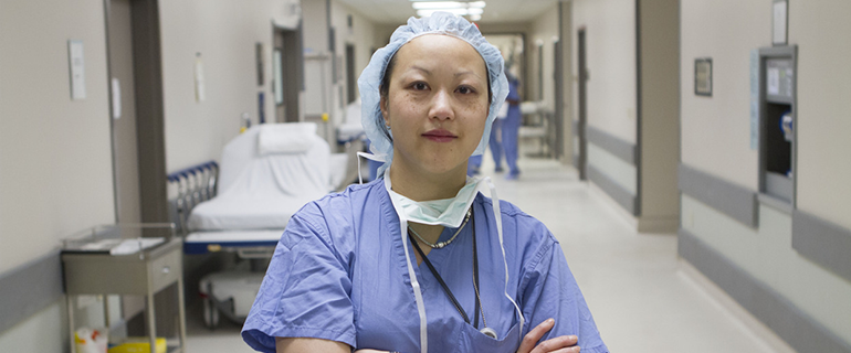 female surgeon standing in hospital hall